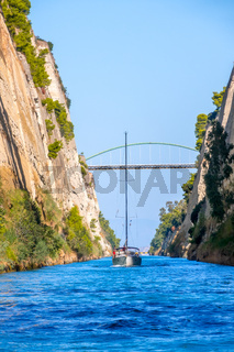 Blue Sky and Yachts Pass Along the Corinth Canal