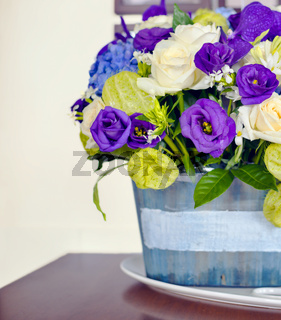 Elegant white and purple flowers on wooden table