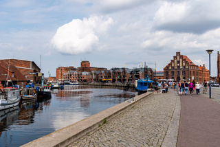 The Old Hansa Harbor of Wismar with boats selling fresh seafood