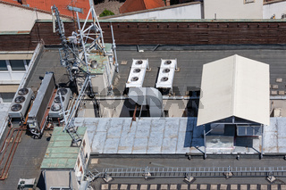 Roof building with communication equipment and air conditioning machinery