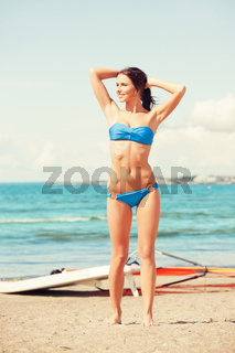 happy woman with wind surf on the beach