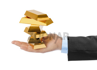 Hand with gold bars