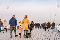 Wooden pier in Sopot in the spring. Good windy weather. winter day on old wooden pier in Sopot, Poland February 9, 2020. people walking on wooden pier in Sopot on sunny winter day near the Baltic Sea