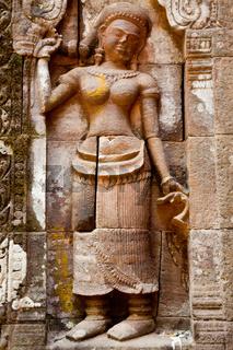 apsara rock carving at the left side of the main door, wat phou, laos
