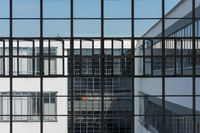 Big window front with partially opened windows of the Bauhaus in Dessau on clear day