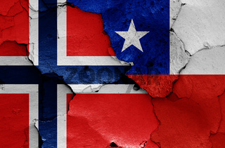 flags of Norway and Chile painted on cracked wall
