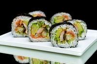 Japanese rolls close-up on black background. horizontal photo.