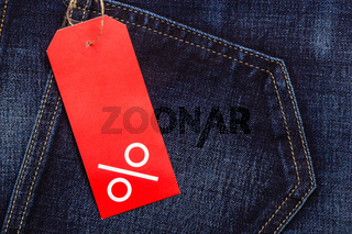 red label with percent sign on denim