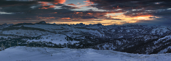 Amazing sunset alpenglow panorama view to snow covered mountain ranges and dramatic sky in cold winter. View from Riedberger Horn to Allgau Alps Mountains, Ifen and Austria. Bavaria, Germany.