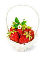 Strawberry in wicker basket with leaves