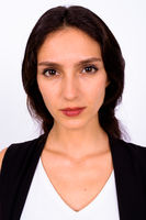 Portrait of young beautiful businesswoman against white background