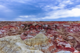 Colored rock formation against blue sky at Wucaitan (Five Colored Hills aka Rainbow Beach)