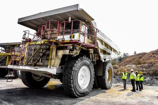 Large Dump Trucks transporting Coal ore for processing