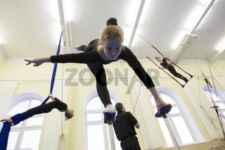 Belarus, Gomel, July 4, 2018. Indicative training circus school.Gymnastic training for children. Girl to study circus art