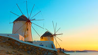 Old windmillls in Mykonos island at sunset