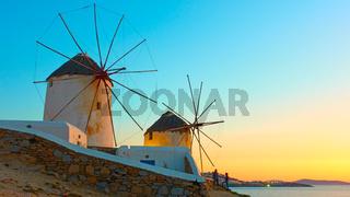 Old windmillls in Mykonos island at sunset