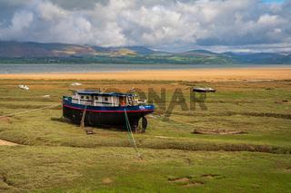 Boats in the grass, seen in Askam-in-Furness, Cumbria, England