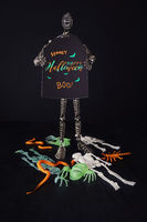 Metal mannequin holding Halloween sign