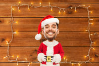 happy santa over garland on wooden background