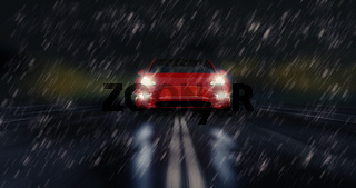 Red sports car drives fast through the rainy night