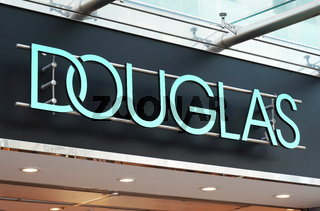 company name sign of Douglas perfumery chain and local branch store in Hannover, Germany on March 2, 2020