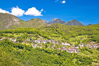 Idyllic village in Dolomites Alps above Garda lake view