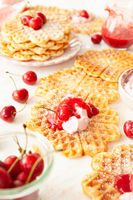 Sweet waffles with fresh cherries