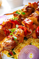 Shish kebabs with vegetables and bulgur
