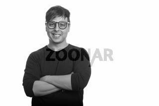 Portrait of happy nerd man wearing eyeglasses in black and white