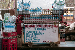 A potable mobile outdoor market vendor food stall display with soda water, soft drinks and water bottles in a roadside eatery in hot summer. Kolkata West Bengal India South Asia Pacific January 2020