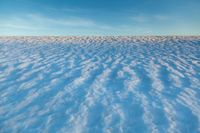Natural winter background with snow drifts