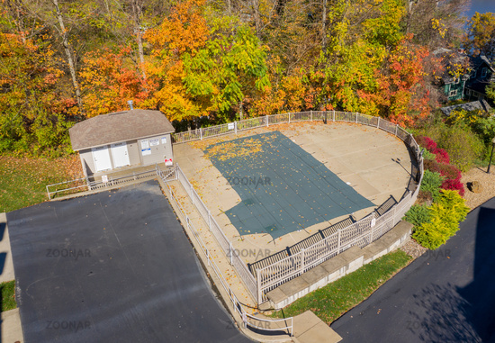 Aerial drone photo of the swimming pool covering protecting the facility from autumn leaves