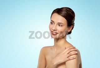 beautiful young woman touching bare shoulder