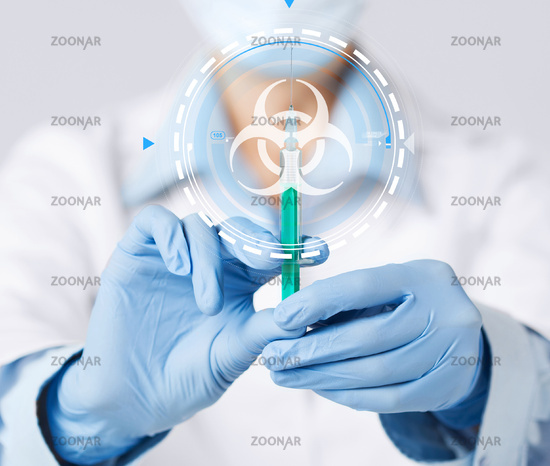 hands in gloves with syringe and biohazard sign