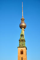 The famous Television Tower and the tower of the Marienkirche at the Alexanderplatz in Berlin