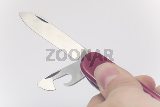 Red knife isolated on white background