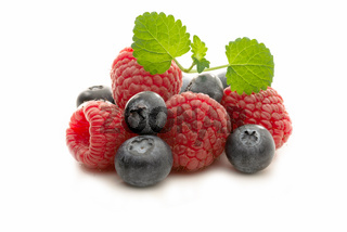 Fresh raspberries and blueberries isolated
