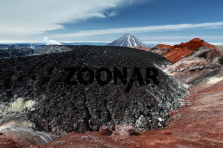 Scenery volcanic landscape - frozen lava field in colorful crater of active volcano Kamchatka