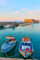 Fishing boats in the harbour near the Venetian Fortress in Heraklion