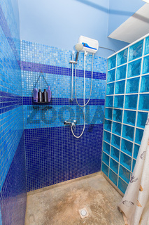 Shower cubicle with blue wall tiles