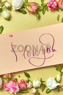 Festive card with text and fresh natural flowers frame.