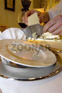 Parmesan or Parmigiano-Reggiano, a italian granular cheese