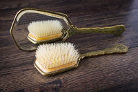 Hand mirror and hair brush
