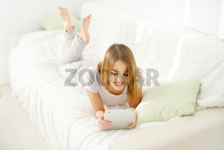 Young attractive girl with tablet pc