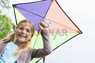 Portrait of a cute girl with a kite