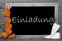 Balckboard With Orange Heart Decoration, Text Einladung Means Invitation