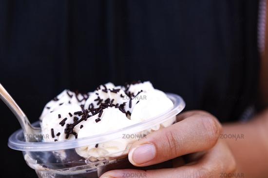 Woman eating chocolate pudding.