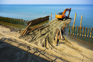 coastal protection measures, construction equipment on the shore, the construction of breakwaters