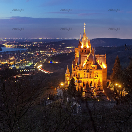 Illuminated Drachenburg Castle above the Rhine Valley in the evening, Koenigswinter, Germany, Europe
