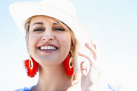 Happy stylish woman standing